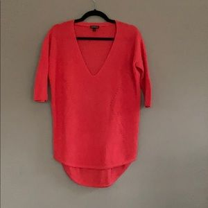 V-Neck coral sweater with 3/4 sleeves.